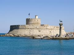 01_Harbour-Gates-and-Lighthouse-St.-Nicholas-at-Rhodes,-Greece.-There-are-also-two-bronze-deer.-Erected-where-probably-the-famous-Colossus-of-Rhodes-used-to-stand